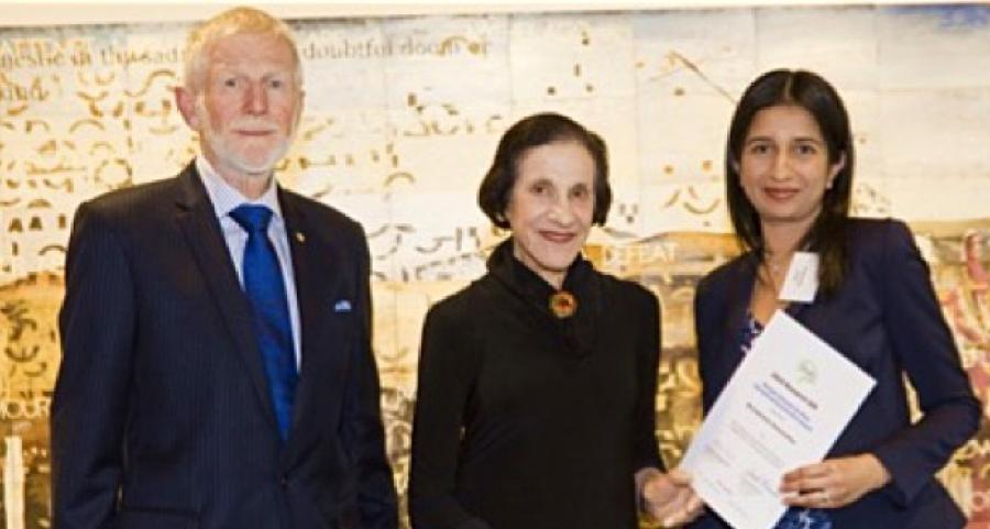 Photo of Dr Darshi being awarded grant from the brain foundation